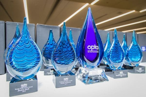 OPTA Annual Conference awards on a table.