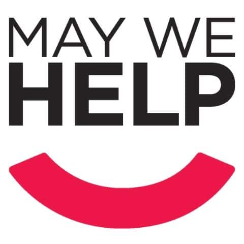 "The logo for May We Help, a program that provides free services to people with disabilities. The logo is simple text reading, ""May We Help"" with a pink smile underneath."